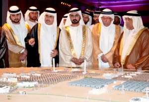 Sheikh Mohammed reviews a model of the Mohammed bin Rashid Al Maktoum Solar Park with Dubai's Supreme Council of Energy.
