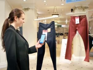Store's shopping technology: Display clothing not in piles or on racks but as one piece hanging at a time, like a gallery. Shoppers just touch their smartphones to a coded tag on the item and then select a color and size via their phone. Technology in the store keeps track of the items, and by the time a shopper is ready to try them on, they're already at the dressing room. (AP Photo/Hointer)